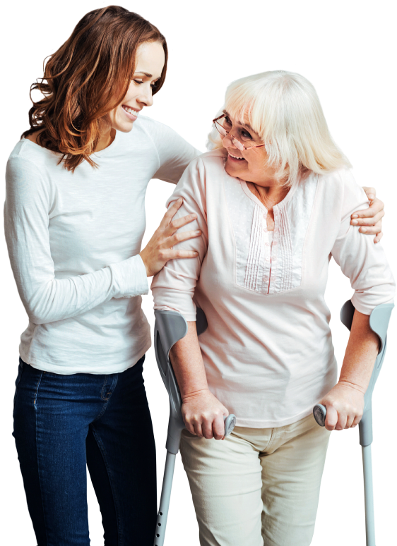 caregiver assisting senior woman to walk while smiling