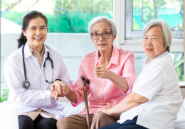 two senior women are nurse are smiling