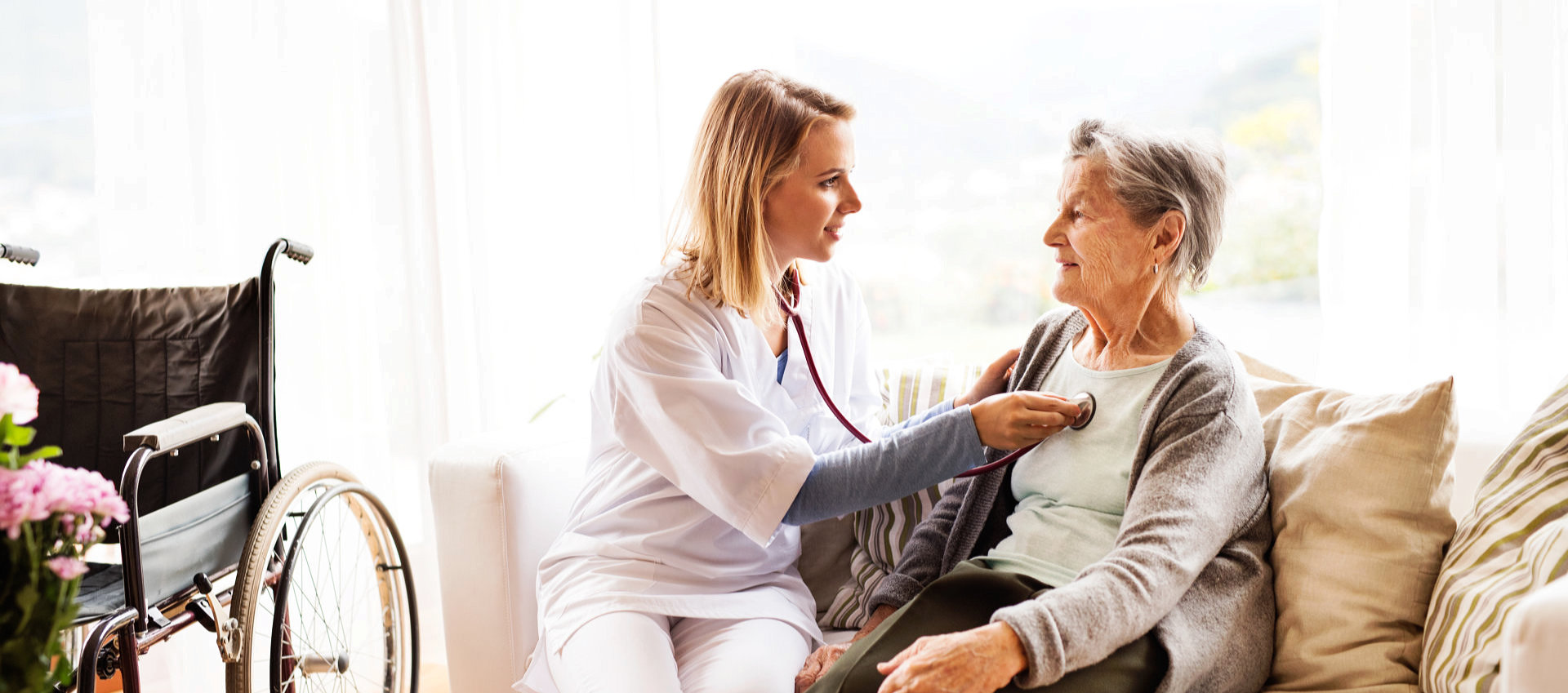 nurse checking the heartbeat of senior woman