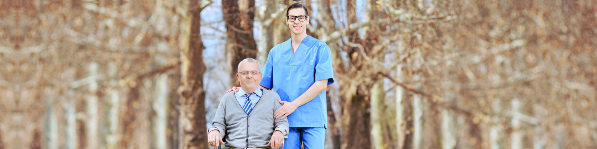 male nurse and senior man are smiling